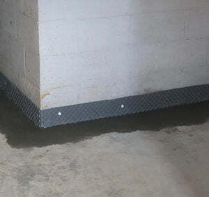 newly poured basement floor with water drainage installed