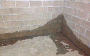 water seeping into basement corner
