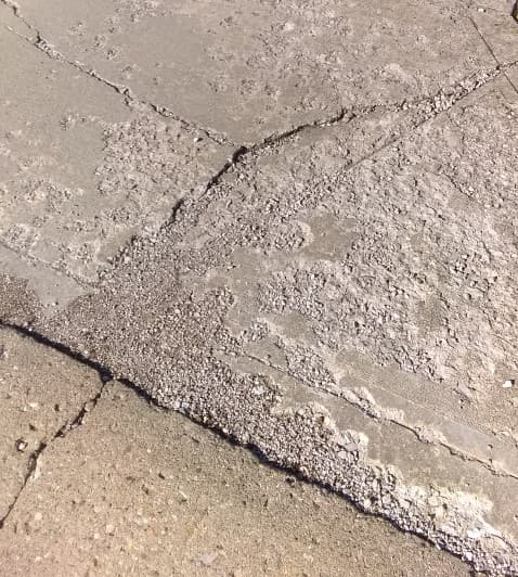 badly cracked driveway