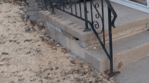 decaying porch foundation