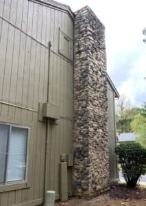 stone chimney leaning away from house