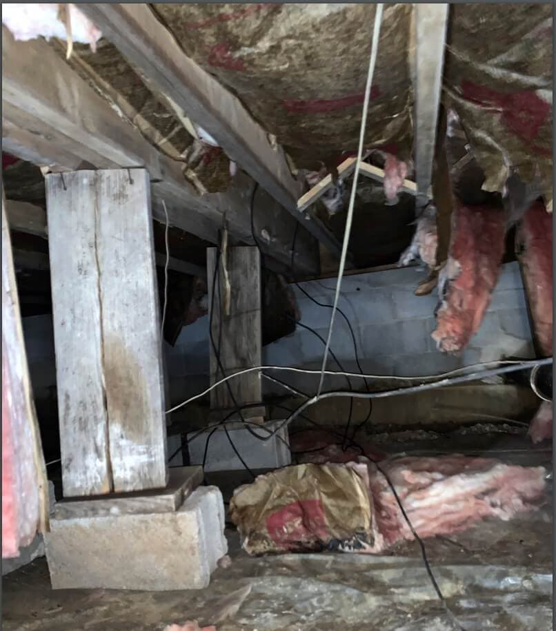 crawl space filled with debris