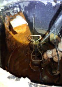 orange sludge in a water pipe