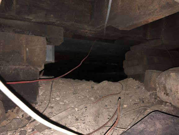 crawl space with crumbling support columns
