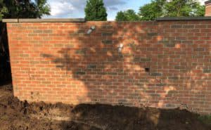same brick wall, now repaired