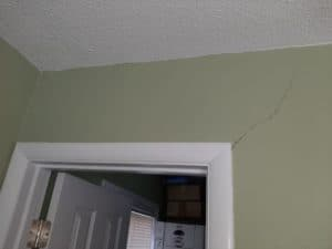 crack in drywall around door