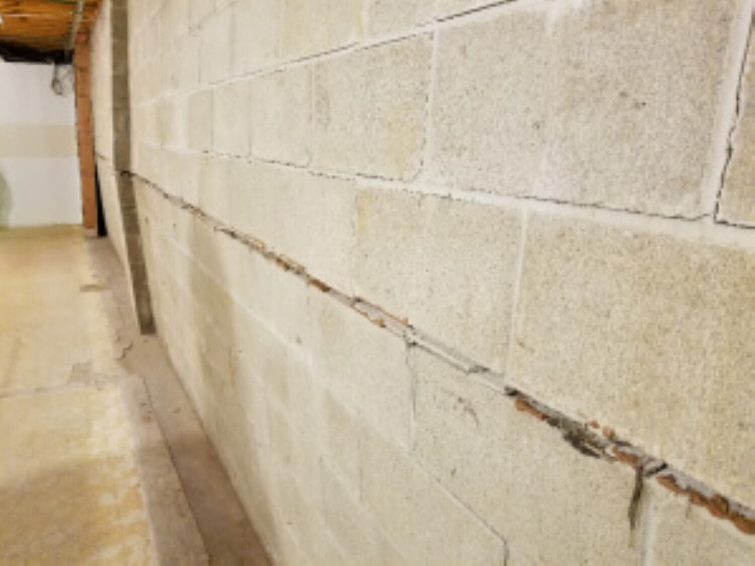 crack in block concrete wall, wall bowing inward