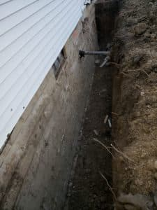 excavation next to wall