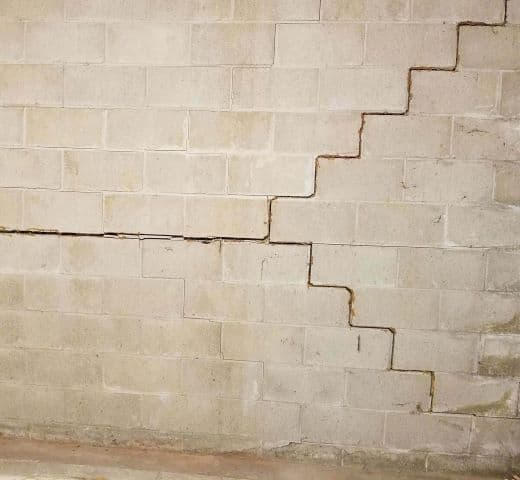 concrete block wall, with multiple cracks