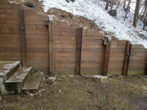 retaining wall repaired by helical tiebacks
