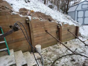 same retaining wall, during repair