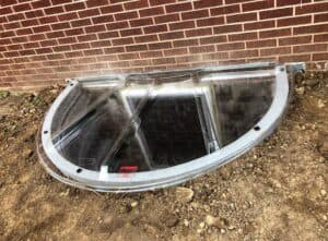 fully installed egress window with well