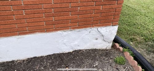 stucco and brick foundation