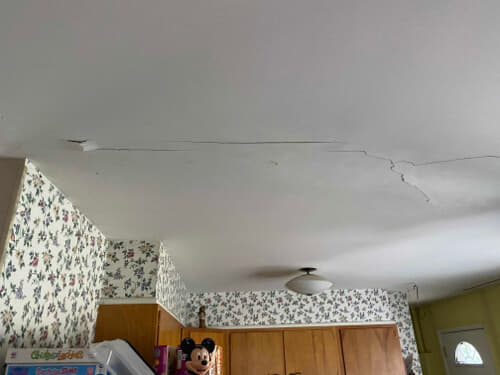 Cracked kitchen ceiling caused by foundation settling.